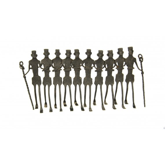 A group of dancing tribal men in wrought iron.