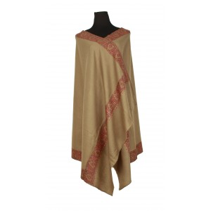 A soft-tan pure wool shawl, with a embroidered border in tones of red.